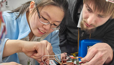 NYIT students with electronics