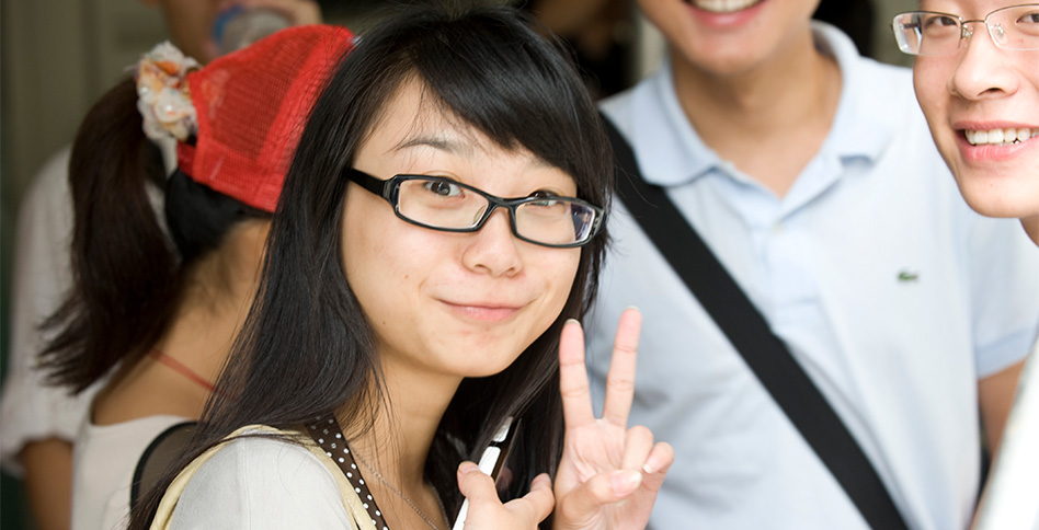 Chinese student giving peace sign