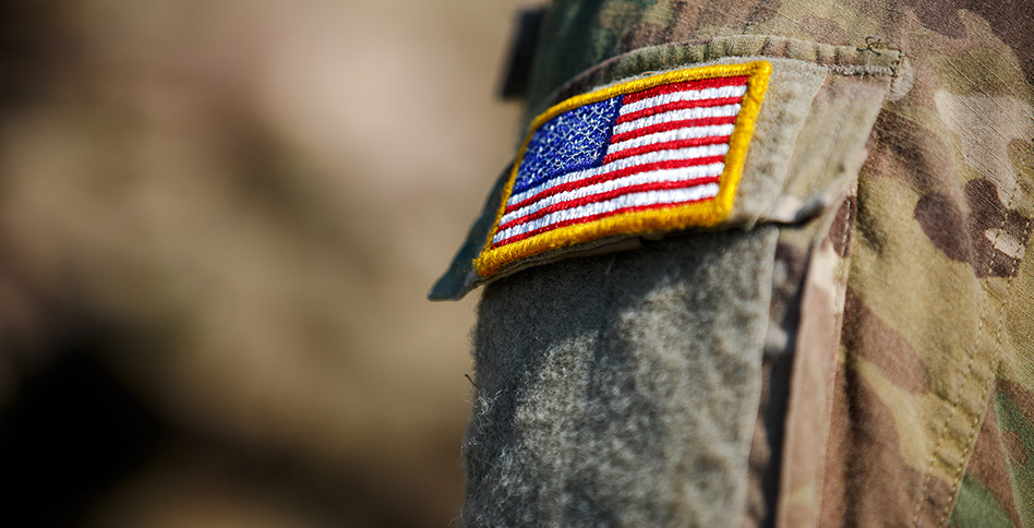 Close-up of an American flag patch on a soldier