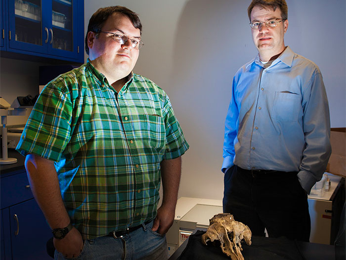 Morgan Churchill, Ph.D. and Jonathan Geisler, Ph.D. with 27-million-year-old fossil skull of Echovenator