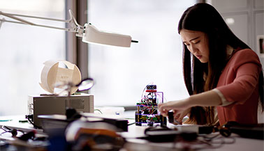 NYIT student working on a robot