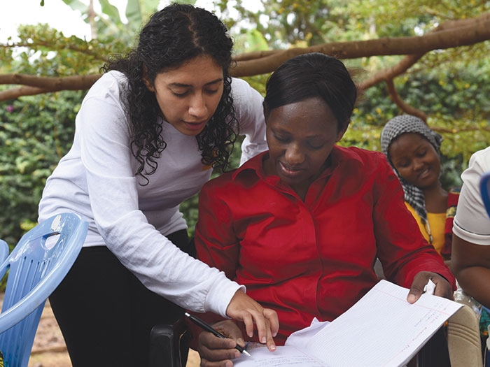May Sefin and Beatrice Temba discuss business plan development at the Excel Education Foundation in Moshi, Tanzania.