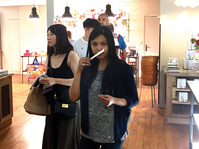 NYIT students walking in a Parisian shop.