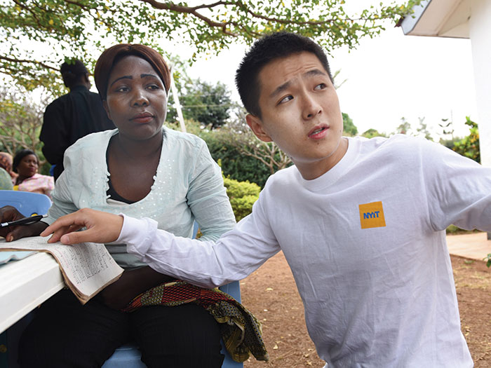 Panfeng Liu helps Renalda Materu learn about conducting business in English at the Excel Education Foundation in Moshi, Tanzania.
