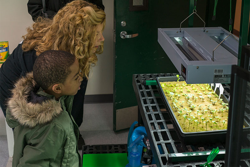 Kate O'Hara shows student the hydroponic garden.