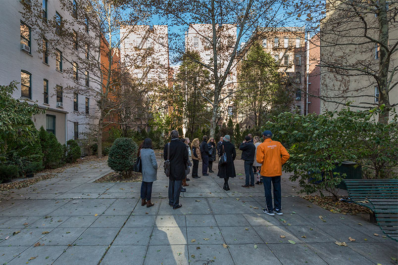The group visits a public green space on 148th Street.