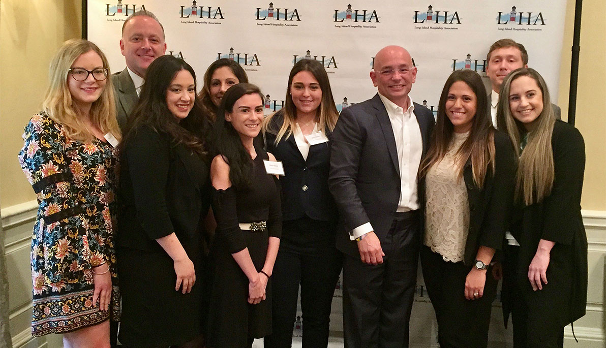 8 NYIT students and alumni stand with James Dunne and Anthony Melchiorri