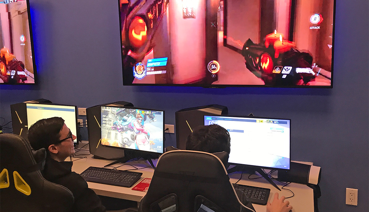 NYIT students playing video games in the eSports arena.