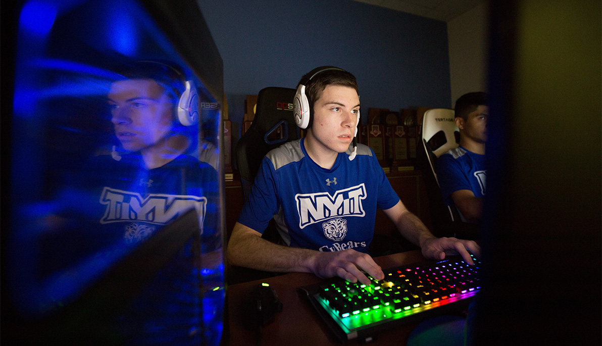 NYIT CyBears athlete playing video games.