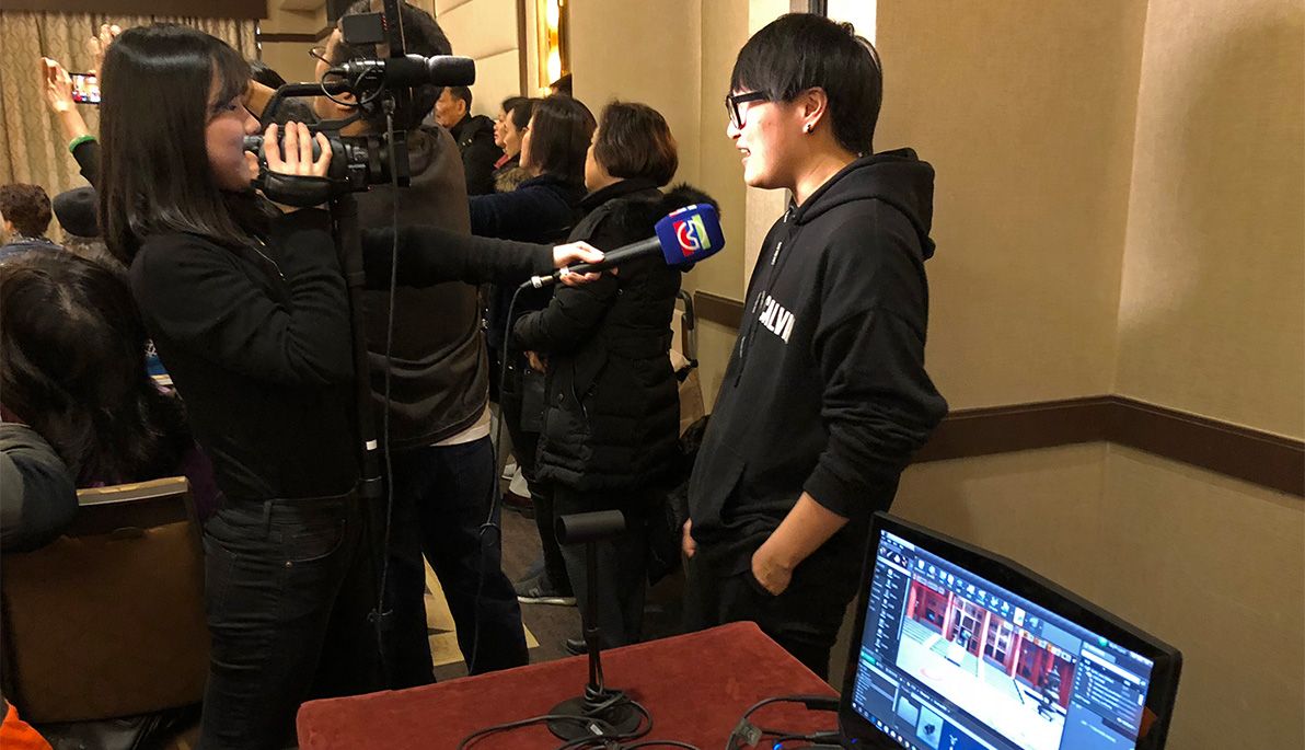 NYIT alumna Yuhan Song speaks to Chinese media.