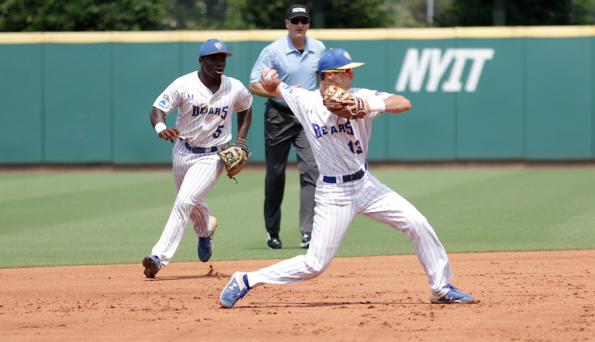 Two NYIT baseball players on the field.