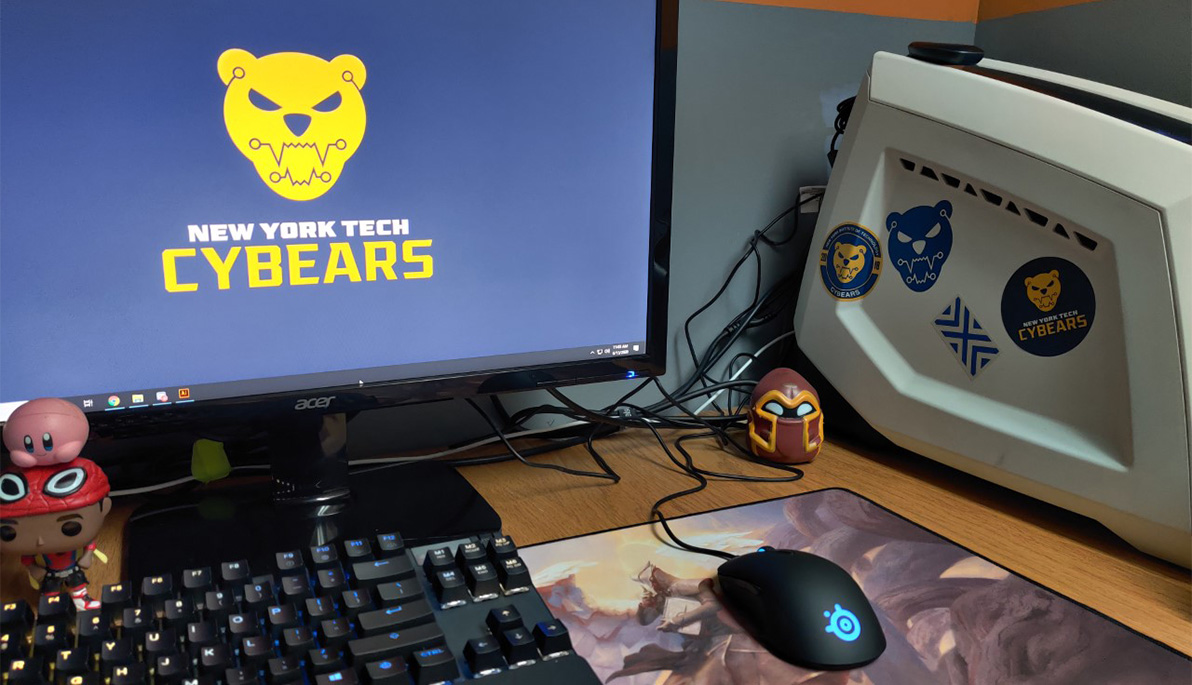 Desktop computer with monitor displaying CyBears logo