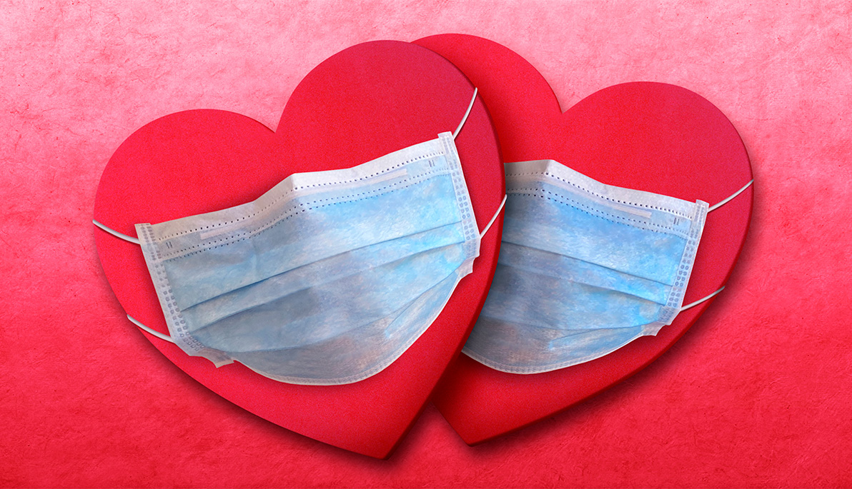 Two hearts wearing surgical masks.