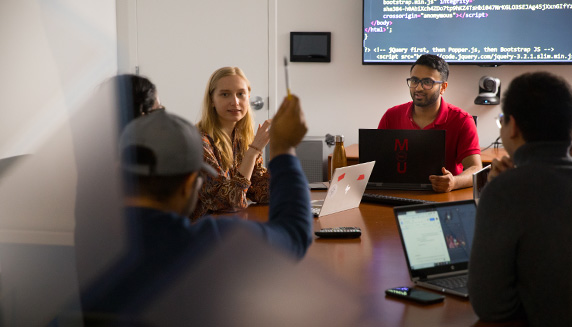Computer science students conversing in a meeting