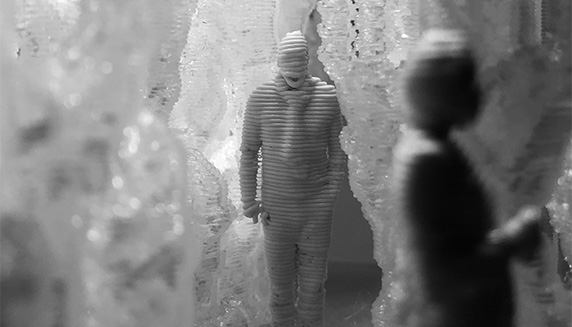 3d man pushing out of a cracked wall
