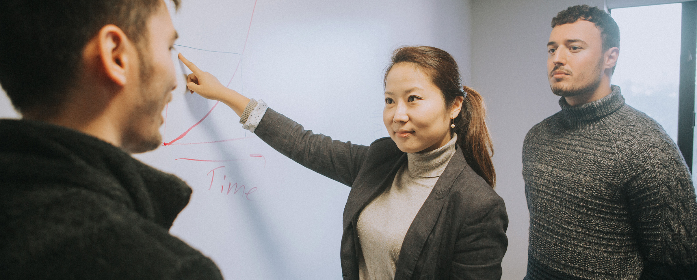 Professor pointing at white board
