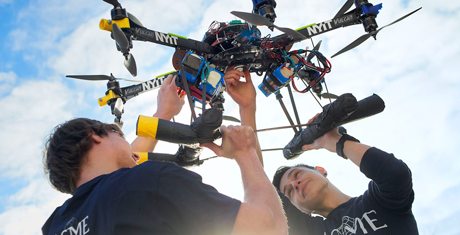 Students with drones above their heads