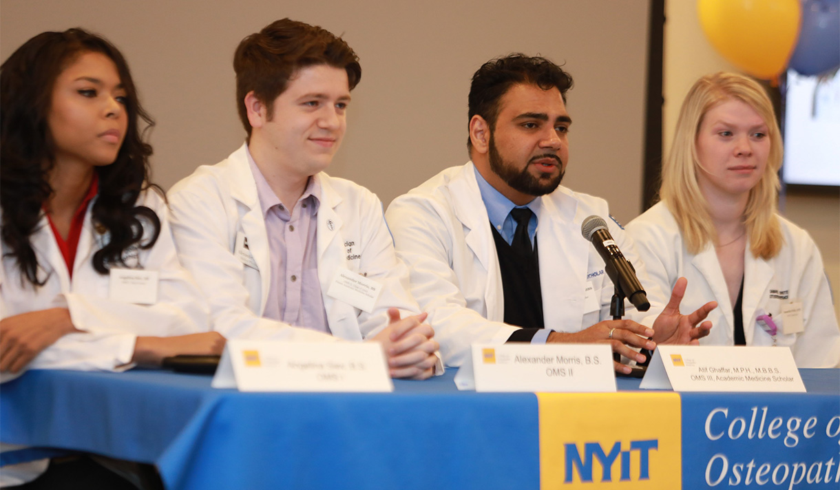 NYITCOM students sitting together on a panel stage.