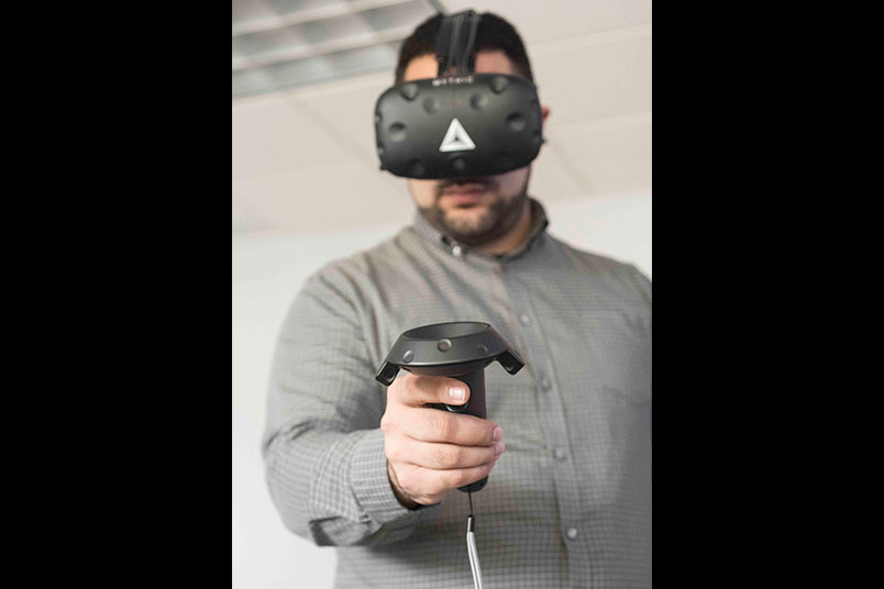 Andy Christoforou wears the virtual reality gear.