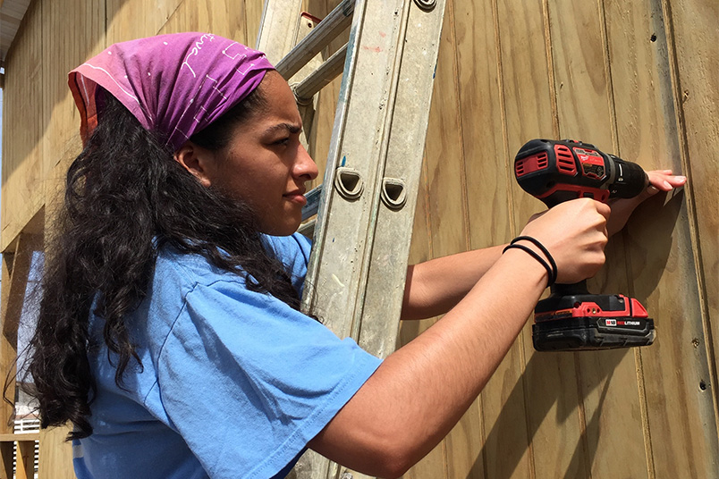 NYIT students hard at work reinforcing roofs, doing light framing, and installing hurricane clips for new homes for displaced families in Puerto Rico.