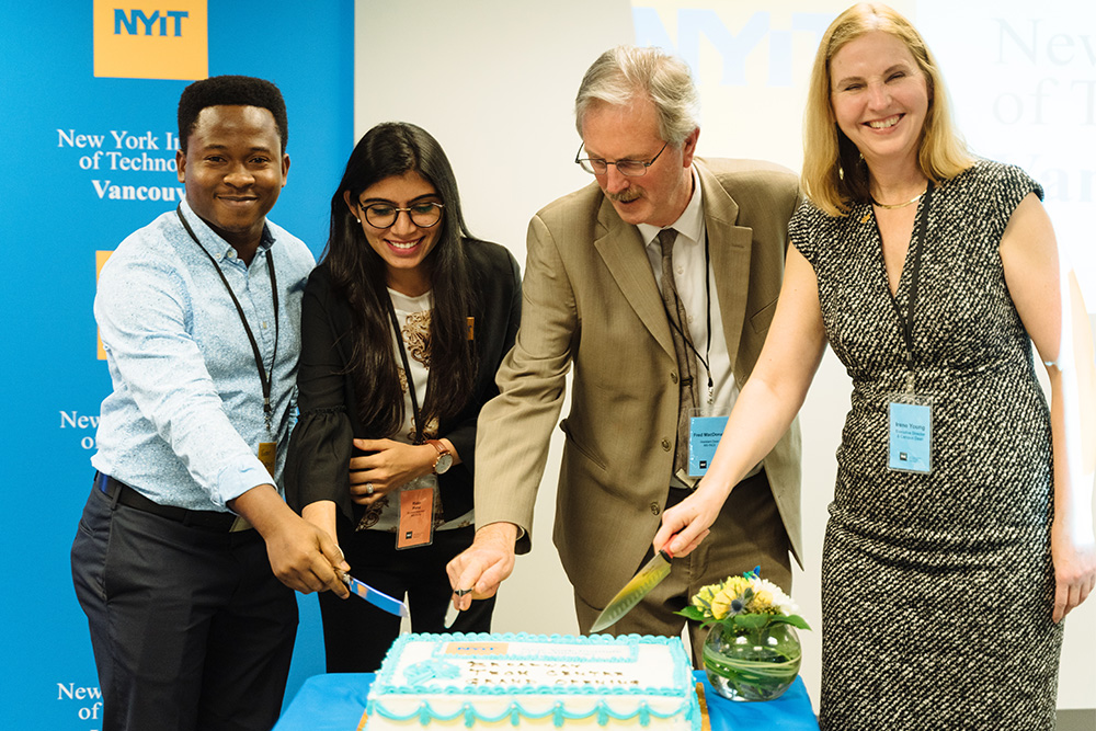(From L to R) Victor Badejo, Riddhi Patel, Fred MacDonald, and Irene Young cut the grand opening cake.<br><br><em>Photo Credit:  Darko Sikman, Darkoroom Photography & Video Production</em>
