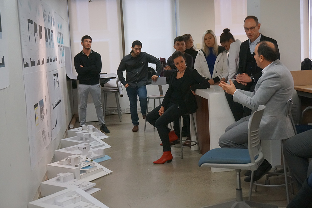 Professor David Diamond (standing at right) and Associate Professor Marcella Del Signore (seated) review the work of first-year architecture students.