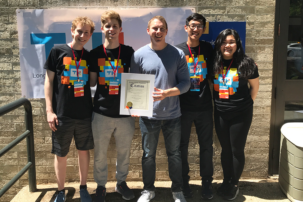 Nassau County Legislator Josh Lafazan presents a citation to the leaders of TeenHacks LI. It recognizes their outstanding work in developing hackathons where high school students can explore their passion for creativity and technology. From left: Quentin Baumann, Wesley Pergament, Lafazan, Jeffrey Yu, and Kaitlin Wan.