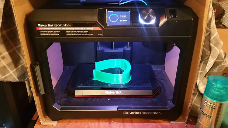 MakerBot 3-D printing the visor piece of the face shield.