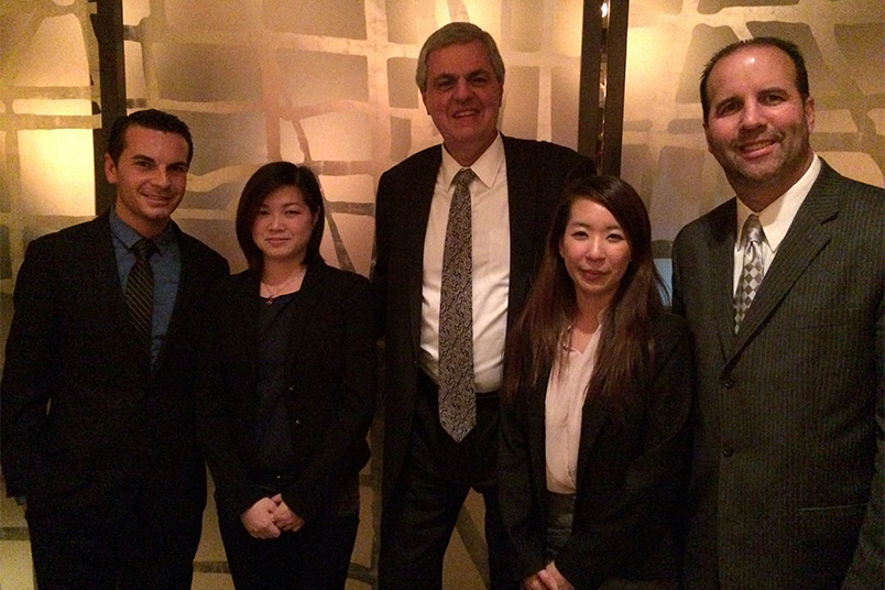 Hotel Association of New York City, Inc. Vice President Richard J. Amato (left) and Office Services Coordinator Craig S. Ranciato (center), meet with NYIT students and Koenig.