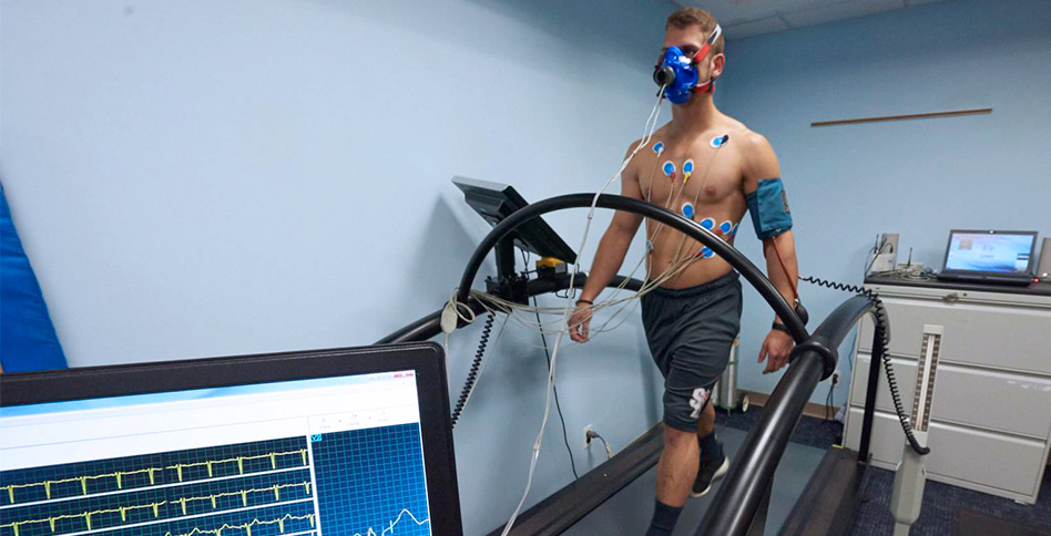 Sports medicine patient having a physical examination while on a treadmill