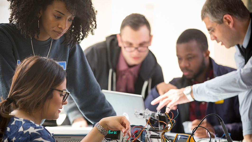 Group of NYIT students rewiring device